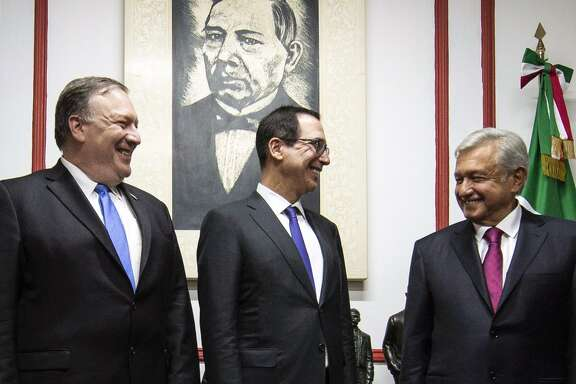 U.S. Secretary of State Mike Pompeo, left, and Treasury Secretary Steven Mnuchin, center, speak with Mexican President-elect Andres Manuel Lopez Obrador at his party's headquarters in Mexico City, on July 13. US President Donald Trump sent a team of top officials to Mexico on Friday to meet with President-elect Andres Manuel Lopez Obrador, an anti-establishment leftist who has been elected at a low point in relations between the neighbors.