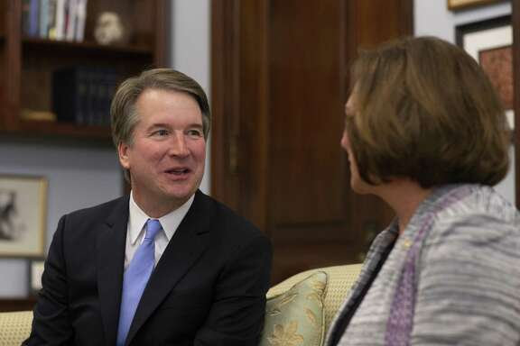 Judge Brett Kavanaugh speaks with Sen. Deb Fischer, R-Nebraska, in her office prior to a meeting in the Russell Senate Office Building on July 12. Trump's nomination of Kavanaugh is bringing our partisan fissures even more in the open.