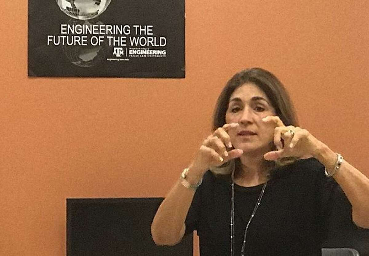 Retired pilot Olga Custodio speaks to students at Harlandale ISD's STEM Early College High School about persevering through rejection and discrimination.