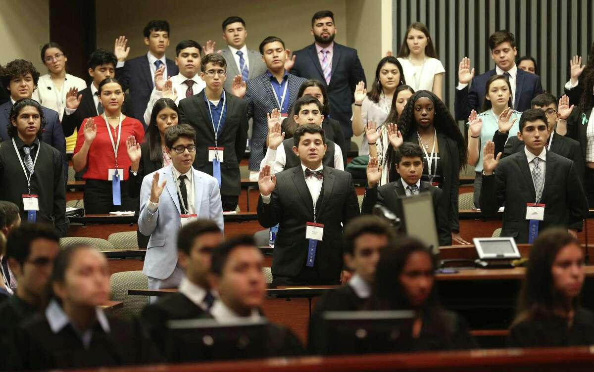 The senators of the National Hispanic Institute's annual Texas Lorenzo de Zavala Youth Legislative Session, a mock legislative session for high-performing Latino high school students, are sworn into office at St. Mary's University Law School during the opening ceremonies of the three-day event.