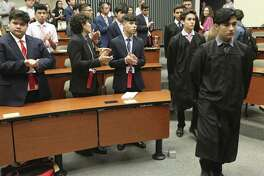 High-performing Latino high school students attend a mock legislative session at St. Mary's University's law school in July. Investment in students such as these will pay dividends.
