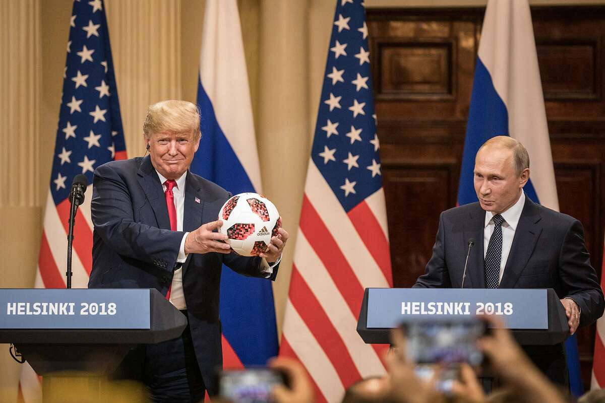 HELSINKI, FINLAND - JULY 16: U.S. President Donald Trump (L) poses with a football given to him by Russian President Vladimir Putin during a joint press conference after their summit on July 16, 2018 in Helsinki, Finland. The two leaders met one-on-one and discussed a range of issues including the 2016 U.S Election collusion. (Photo by Chris McGrath/Getty Images) *** BESTPIX ***