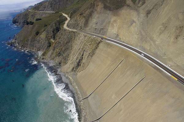 First cars whiz along California's new Highway 1 coastal