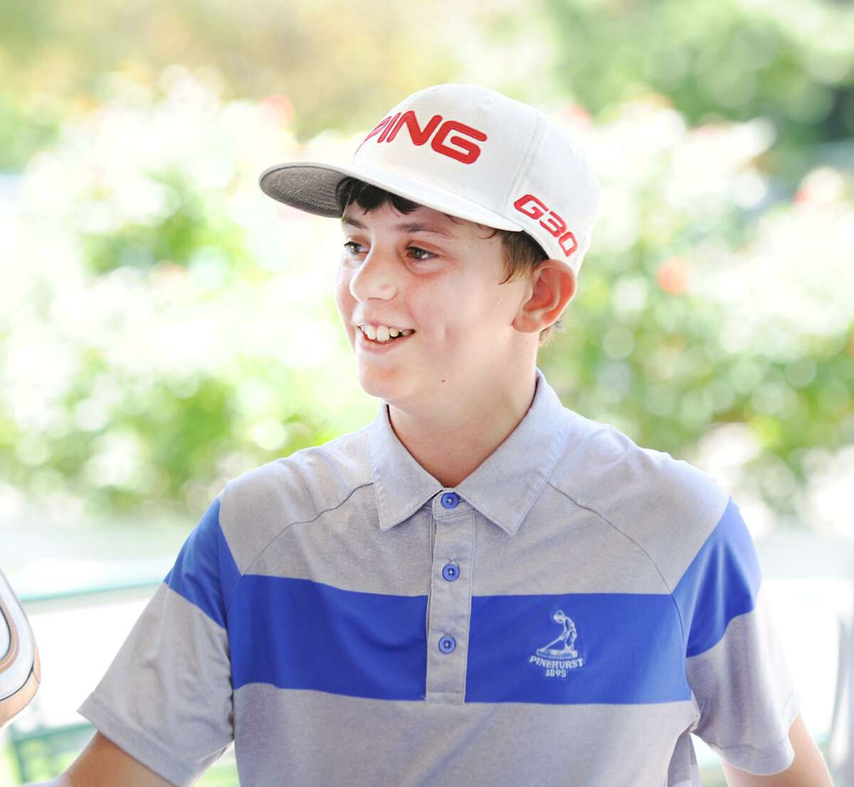 Chad Ruggiero, 12, smiles after winning the boys 10 - 13 age group by shooting an 82 on an 18-hole course during the Joe Felder PGA Greenwich Junior Town Golf Tournament at Griffith E. Harris Golf Club in Greenwich, Conn., Wednesday, July 18, 2018.