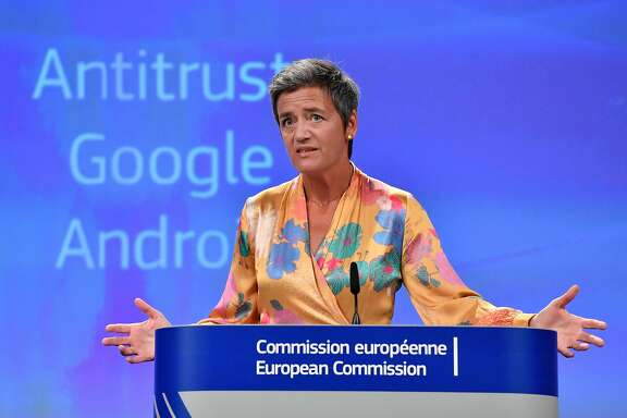 """TOPSHOT - European Union Competition Commissioner Margrethe Vestager gives a joint press at the EU headquarters in Brussels on July 18, 2018.  The EU on July 18, 2018 gave Google 90 days to end """"illegal"""" practices surrounding its Android operating system or face further fines, after slapping a record 4.34 billion euro ($5 billion) anti-trust penalty on the US tech giant.  / AFP PHOTO / JOHN THYSJOHN THYS/AFP/Getty Images"""