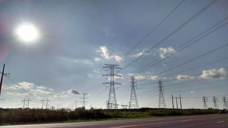 Power lines cross Texas 146 in Galveston County.  NEXT: See tips for keeping your electricity bill low. Photo: Bill Montgomery, Houston Chronicle