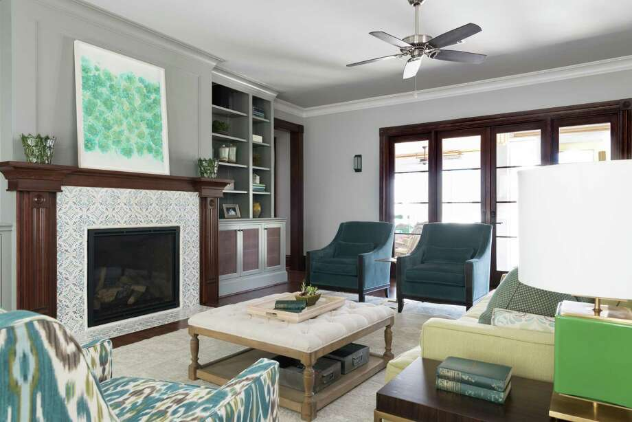 The living room in the  home of Elizabeth and Bobby Poirrier. Linda Eyles  helped them remodel and update several rooms. Photo: Michael Hunter Photography