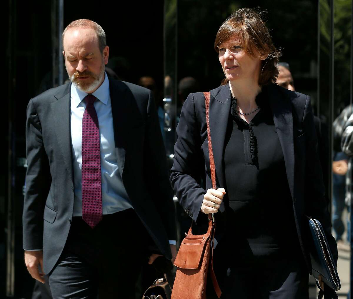 Attorneys August Gugelmann and Mary McNamara leave the Phillip Burton Federal Building and Courthouse after Amer Alhaggagi plead guilty to federal terrorism charges in San Francisco, Calif. on July 18, 2018.
