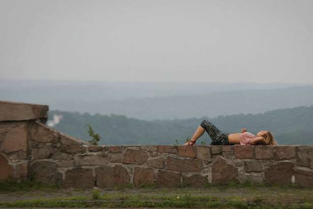 A hiker takes a break atop West Rock Ridge State Park in New Haven.