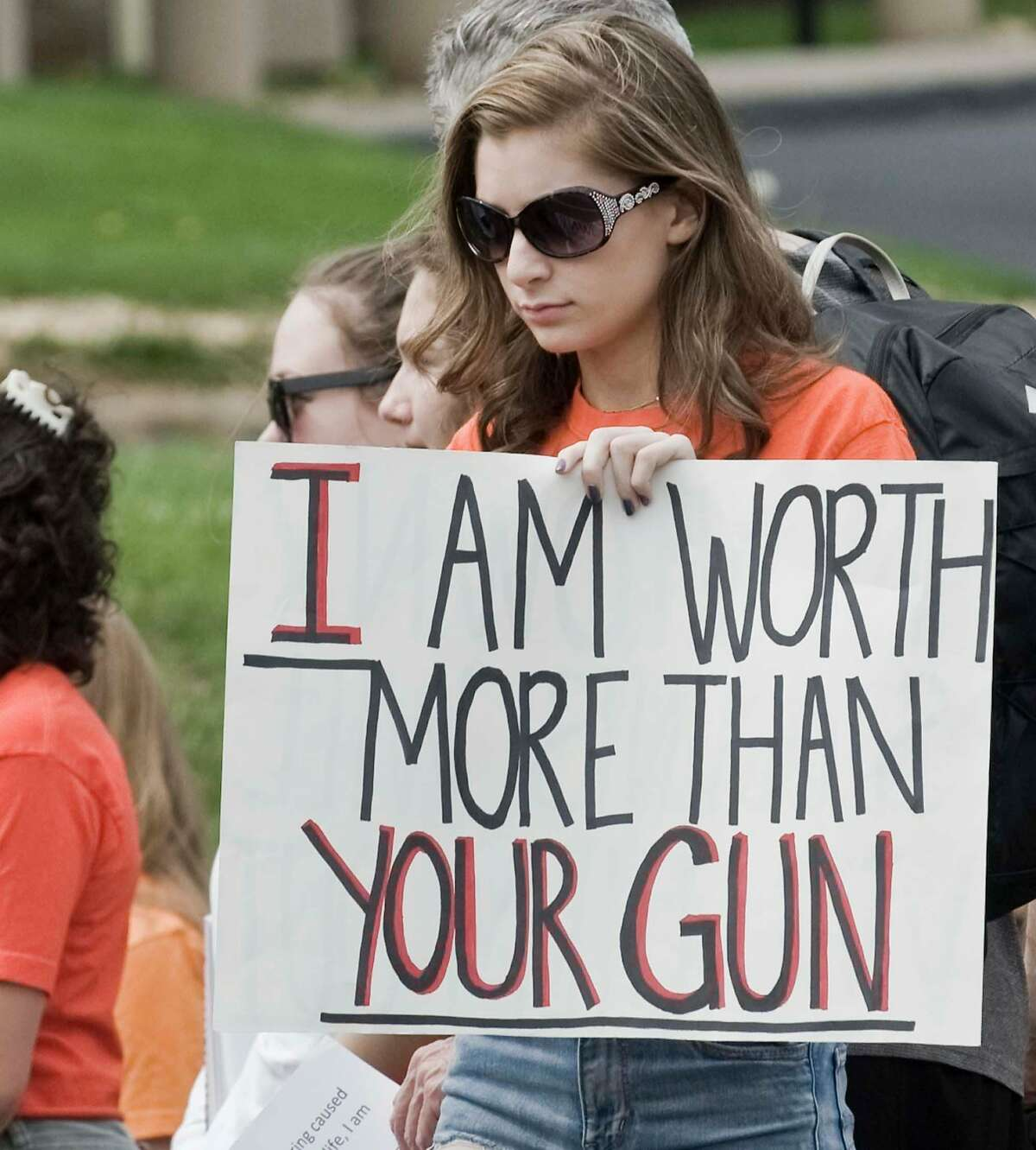 Isabella Wakeman, a junior at Newtown High School, with her statement at the Jr Newtown Action Alliance Club student protest at National Shooting Sports Foundation in Newtown. Saturday, May 5, 2018