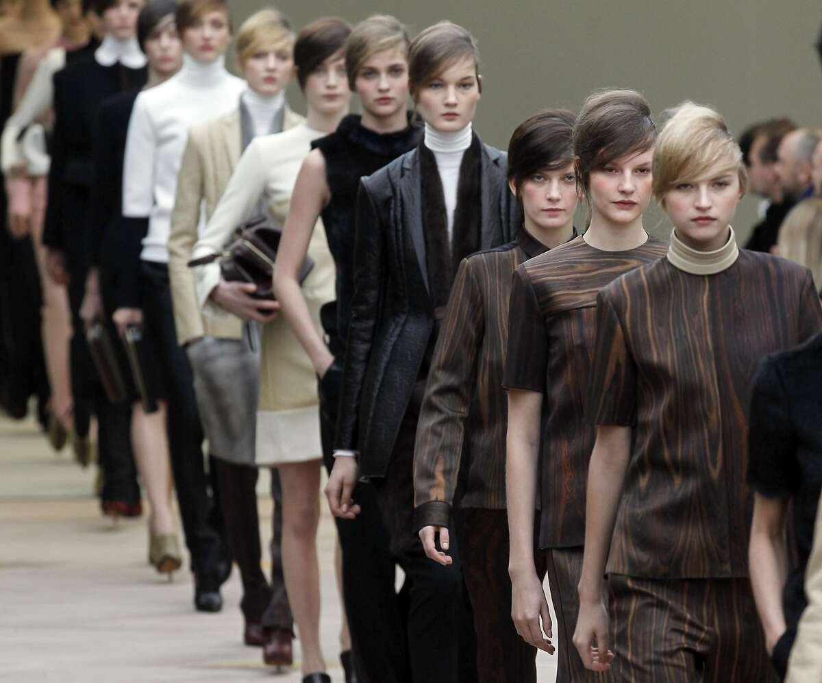 Models display creations by British designer Phoebe Philo for Celine during the Spring/Summer 2012 ready-to-wear collection show on March 6, 2011 in Paris. AFP PHOTO/Francois Guillot (Photo credit should read FRANCOIS GUILLOT/AFP/Getty Images)