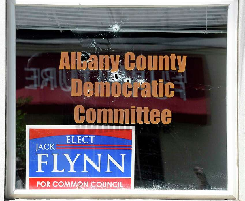 Bullet holes in the window of Albany County Democratic Committee headquarters on Colvin Avenue Wednesday July 18, 2019 in Albany, NY. (John Carl D'Annibale/Times Union)