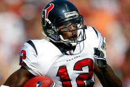 TAMPA, FL - NOVEMBER 13:  Receiver Jacoby Jones #12 of the Houston Texans scores a touchdown on the first play from scrimmage against the Tampa Bay Buccaneers during the game at Raymond James Stadium on November 13, 2011 in Tampa, Florida.  (Photo by J. Meric/Getty Images)