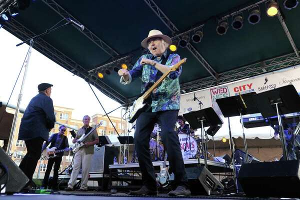 Gene Cornish, of Felix Cavaliere and Gene Cornish's Rascals, punches the air while performing as the headliners of Wednesday Nite Live at Columbus Park in downtown Stamford, Conn. on Wednesday, July 18, 2018.
