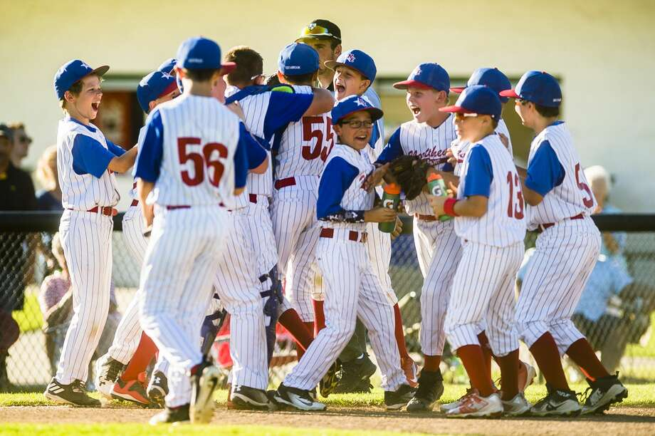 Midland Northeast players celebrate after their 11-year-old Little League Baseball district final victory over Gladwin on Wednesday, July 18, 2018 at Plymouth Park. (Katy Kildee/kkildee@mdn.net) Photo: (Katy Kildee/kkildee@mdn.net)