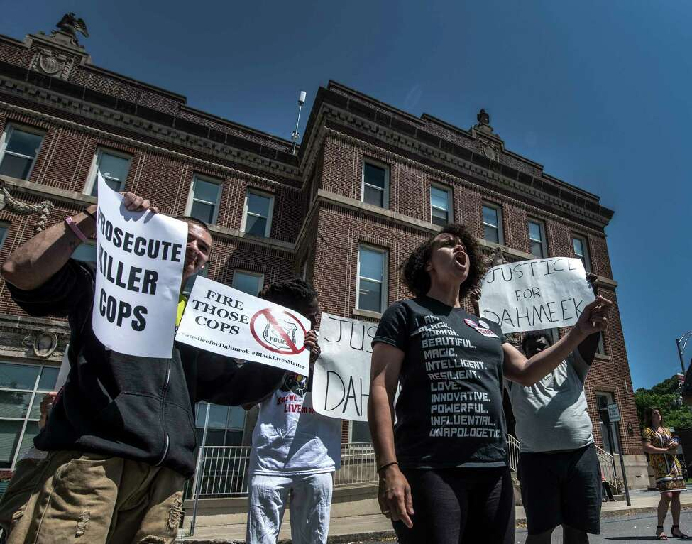 Jamaica Miles of Citizen Action of New York speaks at a rally outside Troy Police headquarters Wednesday July 18, 2018 in protest of a recent grand jury decision on a police involved shooting. in Troy, N.Y. (Skip Dickstein/Times Union)