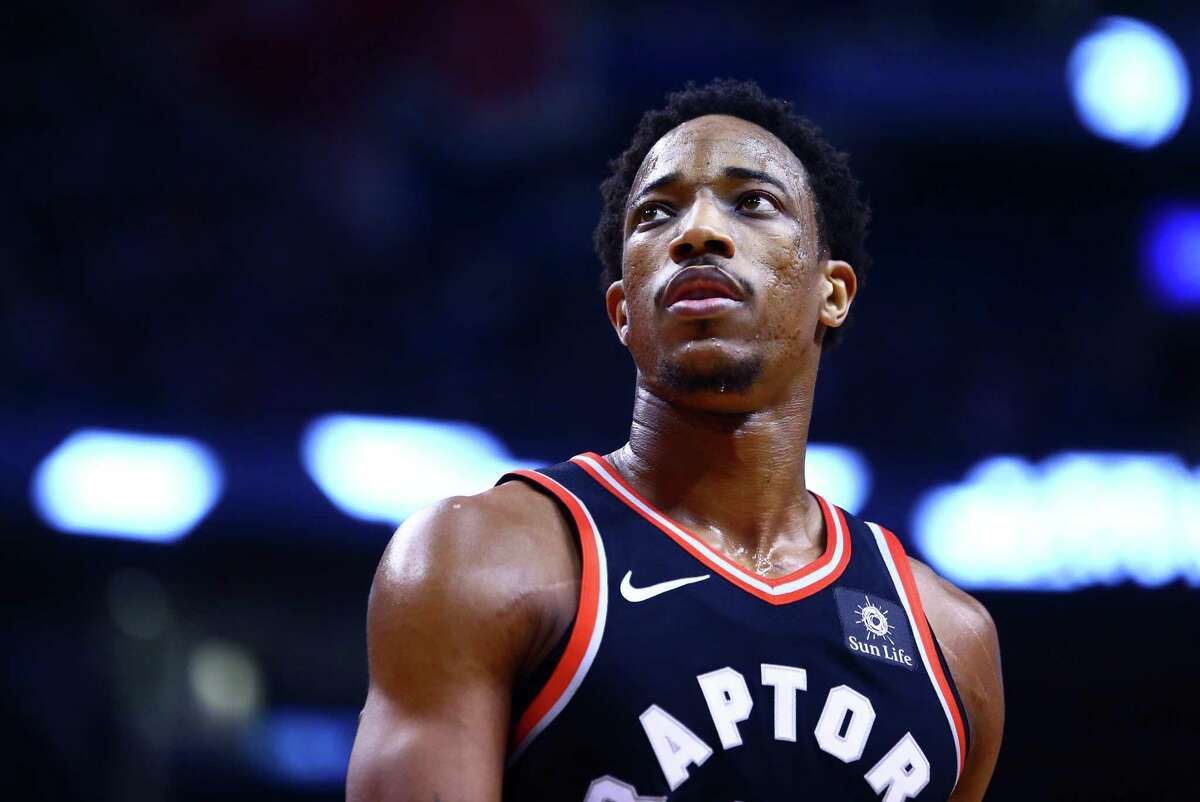 TORONTO, ON - JANUARY 13: DeMar DeRozan #10 of the Toronto Raptors looks on during the first half of an NBA game against the Golden State Warriors at Air Canada Centre on January 13, 2018 in Toronto, Canada. NOTE TO USER: User expressly acknowledges and agrees that, by downloading and or using this photograph, User is consenting to the terms and conditions of the Getty Images License Agreement. (Photo by Vaughn Ridley/Getty Images)