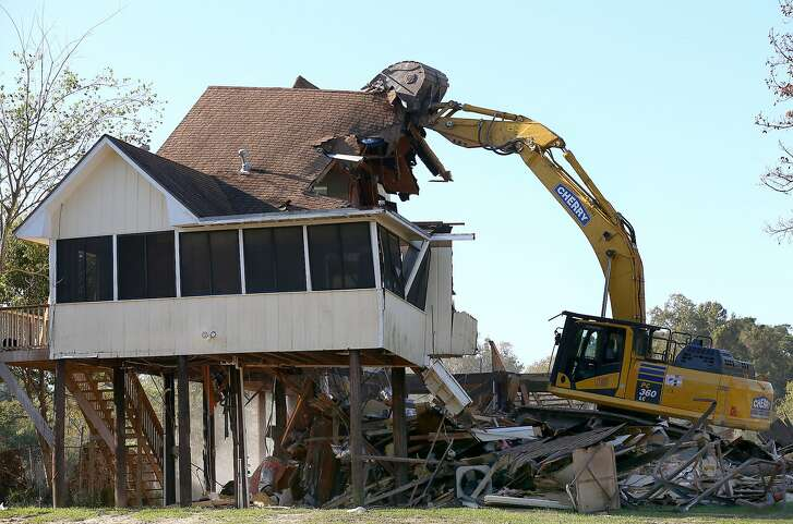 A home that was bought out by Harris County on the 2600 block of Shorewick Drive was the first to be demolished after being flooded during Harvey Friday, Nov. 10, 2017, in Highlands, Texas. ( Godofredo A. Vasquez / Houston Chronicle )