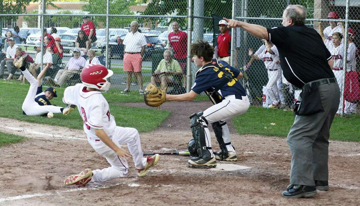 Weston Dylan Delaney attempts to get the force out with bases loaded catcher Michael Amato (31) on Fairfield American Robbie Donahue (13), who scored on a bunt by Timmy Donahue (9) in the fourth inning of a Section 1 Little League tournament baseball game on July 18, 2018 in Stamford, Connecticut. Fairfield American won 1-0.