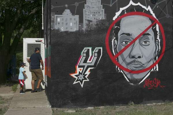 Within hours of an announcement Kawhi Leonard had been traded off the Spurs' roster, a mural at Countdown City Cuts previously showing support for the player had been changed to show how some people feel about Leonard.