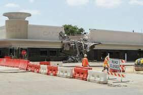 Demolition has begun on part of the River Oaks shopping center Wednesday, July 18, 2018, in Houston.