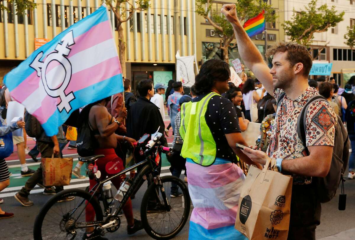 Joe Wadlington makes a fist in support of 15th annual Trans March , Friday, June 22, 2018, in San Francisco, Calif.