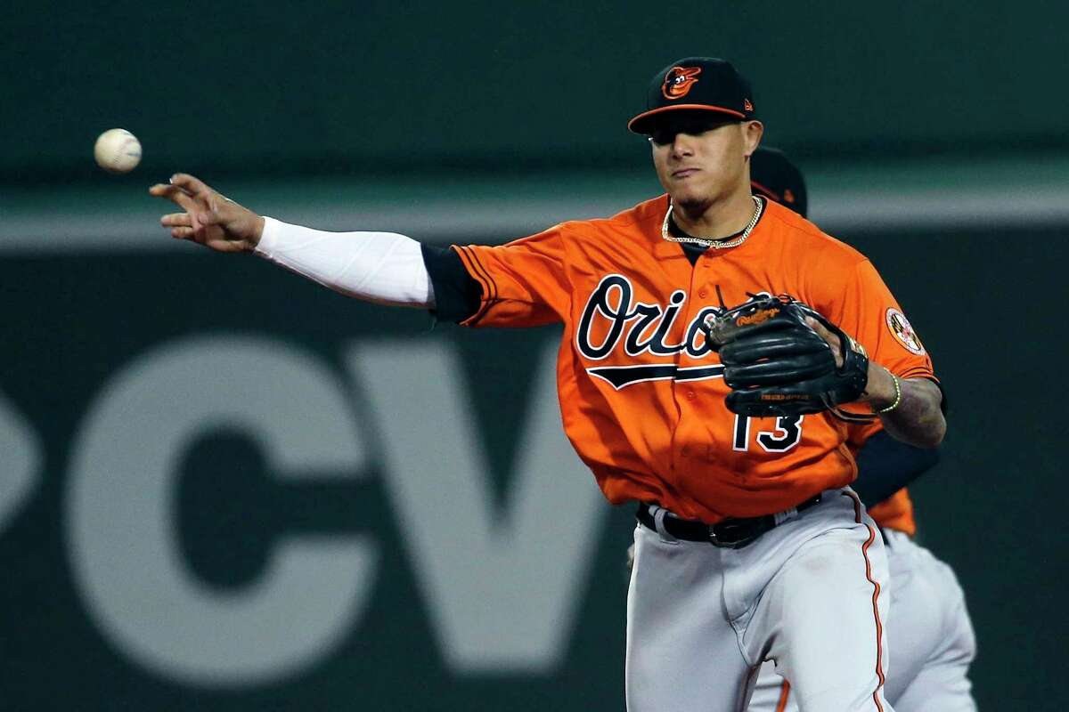 FILE - In this Saturday, May 19, 2018 file photo,Baltimore Orioles' Manny Machado throws to first base to make the double play on Boston Red Sox's Eduardo Nunez during the eighth inning of a baseball game in Boston. (AP Photo/Michael Dwyer)
