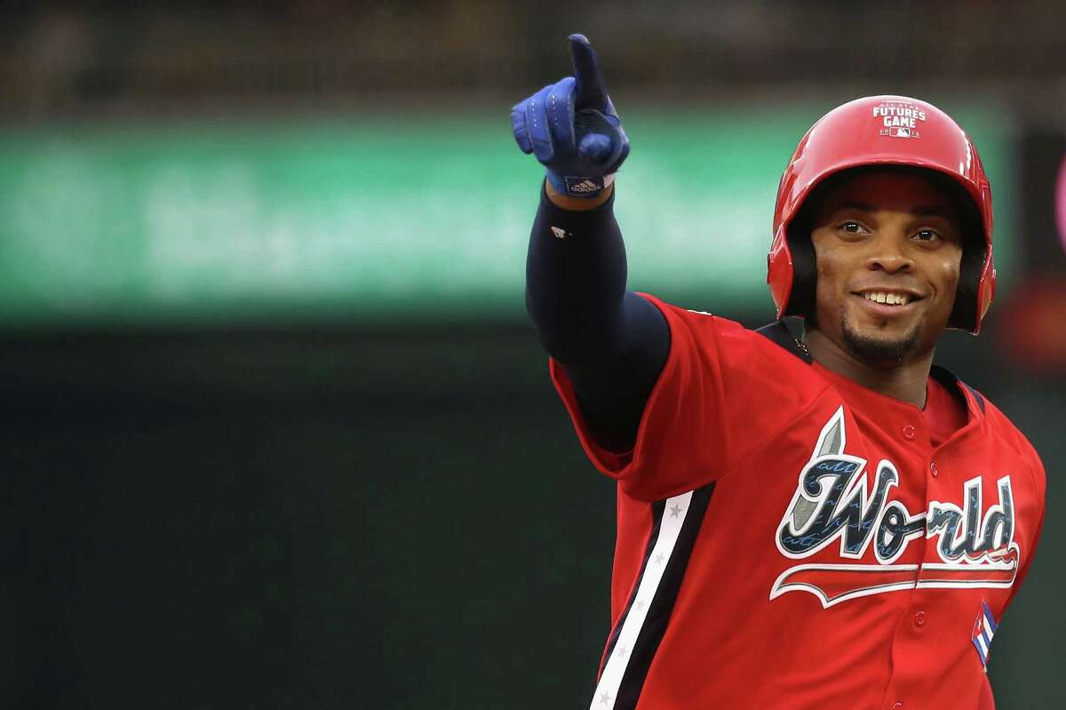 WASHINGTON, DC - JULY 15: Yusniel Diaz #17 of the Los Angeles Dodgers and the World Team celebrates after hitting a solo home run in the seventh inning against the U.S. Team during the SiriusXM All-Star Futures Game at Nationals Park on July 15, 2018 in Washington, DC. (Photo by Rob Carr/Getty Images)