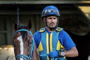 Trainer Rudy Rodriguez rides one of his trainees in the barn area at the Oklahoma Training Center during morning exercise hours as well as keeping his busy schedule on time Wednesday July 18, 2018 in Saratoga Springs, N.Y. (Skip Dickstein/Times Union)