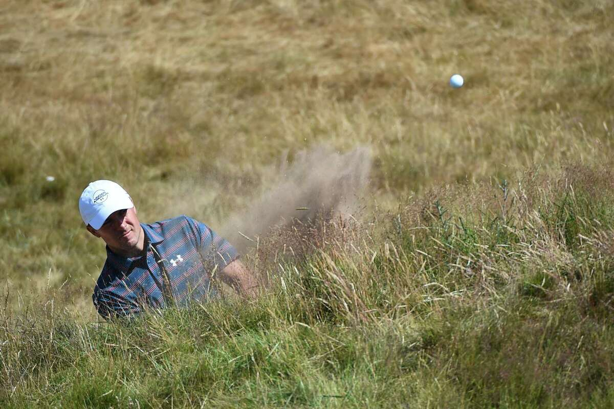 US golfer Jordan Spieth plays from a bunker on the 2nd hole during a practice round at The 147th Open golf Championship at Carnoustie, Scotland on July 18, 2018. / AFP PHOTO / Andy BUCHANANANDY BUCHANAN/AFP/Getty Images