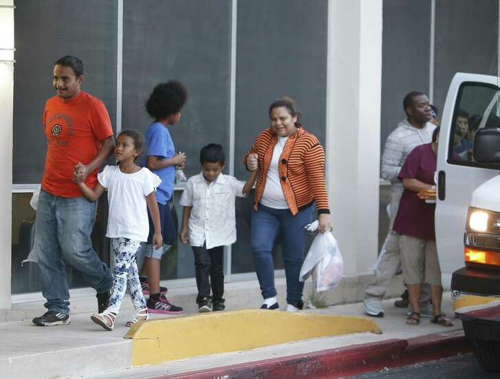 A van of immigrants arrives at Wednesday at Catholic Charities' main office.