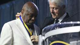 President Bill Clinton present former San Francisco Mayor Willie L. Brown the Thalheimer Spingarn Medal during the 109th annual National Association for the Advancement of Colored People convention at the Henry B. Gonzalez Convention Center in San Antonio, Texas, Wednesday, July 18, 2108.
