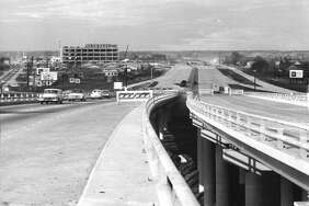 Looking north from the Loop 610 interchange at the Southwest Freeway, January 1963. Joske's Department Store can be seen at left in the background.