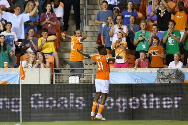 Houston Dynamo forward Romell Quioto (31) celebrates after scoring against Sporting Kansas City goalkeeper Tim Melia (29) during the second half of the U.S. Open Cup quarterfinal match at BBVA Compass Stadium Wednesday, July 18, 2018, in Houston. The Dynamo won 4-2. ( Godofredo A. Vasquez / Houston Chronicle )