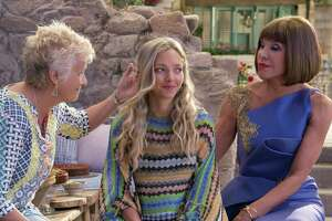 """Sophie (Amanda Seyfried) takes on grown-up responsibilities in the """"Mamma Mia!"""" sequel, with help from her mom's friends Rosie (Julie Walters, left) and Tanya (Christine Baranski)."""