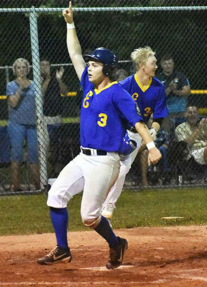 Edwardsville Post 199's Joel Quirin scores the winning run in the ninth inning to beat Alton on Wednesday night in the District 22 Tournament at Hoppe Park in Edwardsville. Photo:     Matthew Kamp / Hearst Newspapers