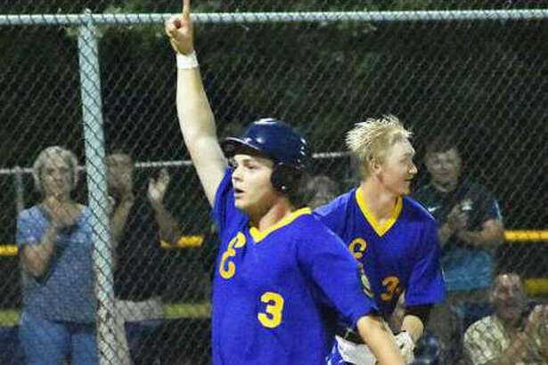 Edwardsville Post 199's Joel Quirin scores the winning run in the ninth inning to beat Alton on Wednesday night in the District 22 Tournament at Hoppe Park in Edwardsville.