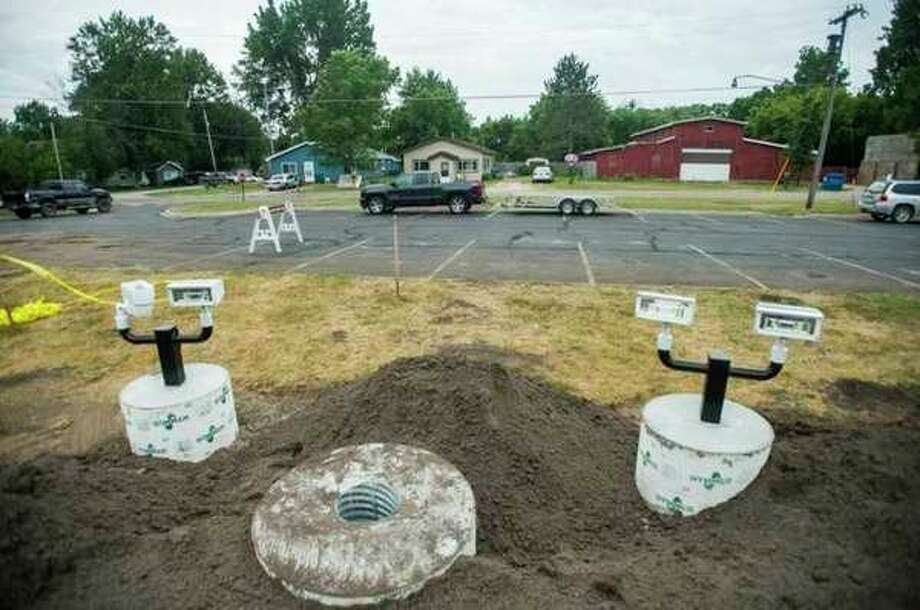 Constructionat the site of the Sanford Flag Memorial. (Katy Kildee/kkildee@mdn.net)
