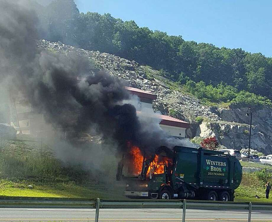 Southbound Route 8 was shut down for about an hour after a Winters Bros garabage truck caught fire on Wednesday, July 18, 2018 in Seymour. The fire, reported shortly after 4 p.m., happened near Exit 20 and the Haynes Outdoor Living Center. Fortunately no one was injured in the fire, but the vehicle was ... trashed. Photo: Seymour Fire Department