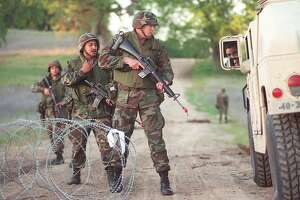 ADVANCE FOR WEEKEND EDITIONS MAY 23-24--Jeff Therault of Oxnard, Calif., center of picture, leads his team to search a vehicle during an Army National Guard training exercise Saturday, April 18, 1998, at Fort Hunter Liggett in central California.(AP Photo/Ventura County Star, K.C. Alfred)