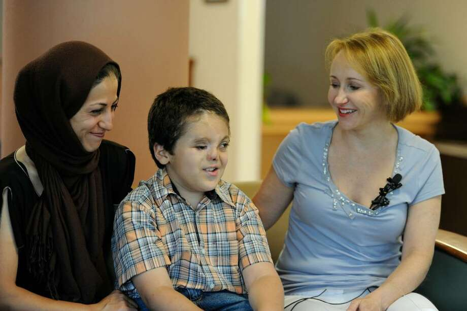"Dr. Lucie Capek, right, performed the most recent surgeries on Mohammad ""Little Mo"" Karimi, shown with his mother, Leila,at Ellis Health Center in Schenectady.   (Skip Dickstein/Times Union) Photo: Skip Dickstein"