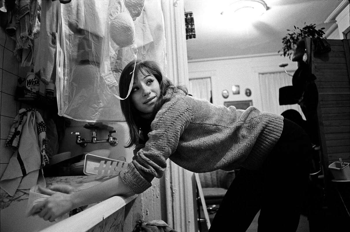 Barbra Streisand washes her clothes in the kitchen bathtub of her New York City apartment, 1963