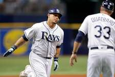 ST. PETERSBURG, FL - JUNE 25: Wilson Ramos #40 of the Tampa Bay Rays is congratulated by third base coach Matt Quatraro #33 after his home run in the sixth inning of a baseball game against the Washington Nationals at Tropicana Field on June 25, 2018 in St. Petersburg, Florida. (Photo by Mike Carlson/Getty Images)