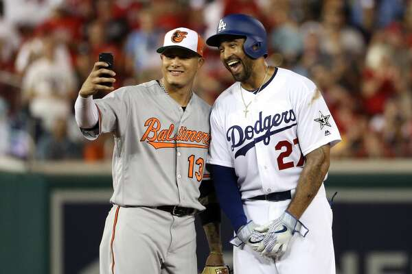 WASHINGTON, DC - JULY 17: Manny Machado #13 of the Baltimore Orioles and the American League and Matt Kemp #27 of the Los Angeles Dodgers and the National League pose for a selfie in the second inning during the 89th MLB All-Star Game, presented by Mastercard at Nationals Park on July 17, 2018 in Washington, DC.  (Photo by Patrick Smith/Getty Images)