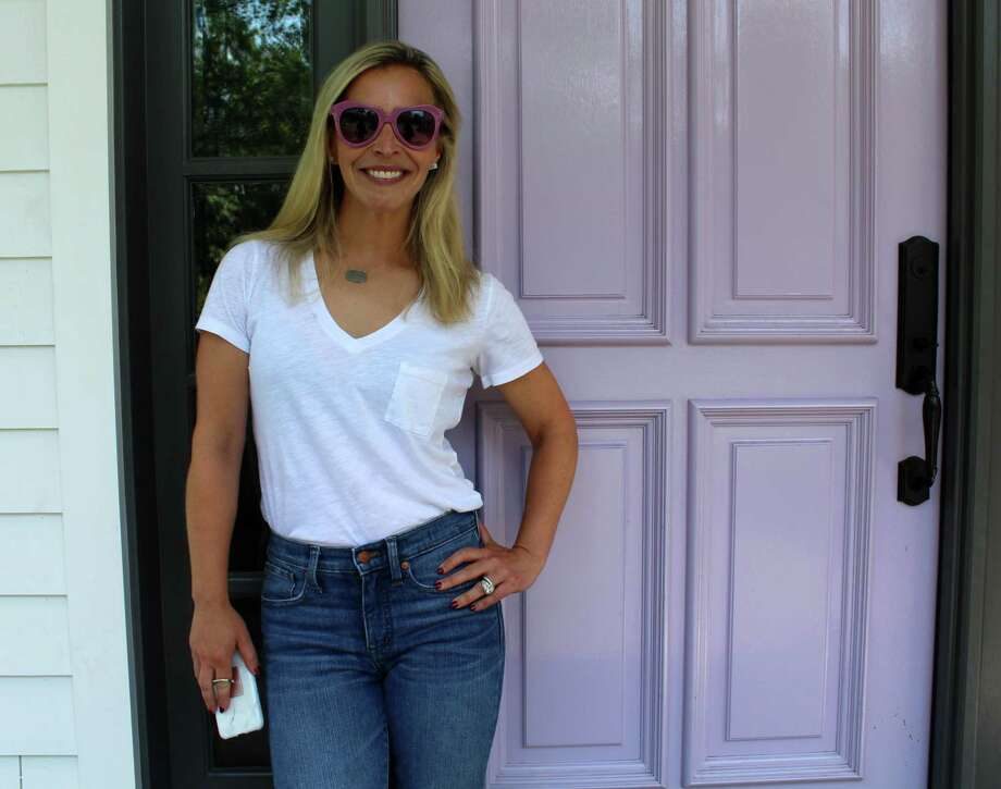 Style and beauty expert Jenn Falik stands in front of her Westport home. Photo: Sophie Vaughan / Hearst Connecticut Media / Westport News