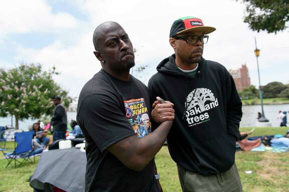 "Onsayo Abram, left, who was one of the men in the now viral video barbecuing at the lake when a woman called the police on them, says hello to Joan Smith during the ""BBQ'n While Black"" party at Lake Merritt in Oakland, CA, on Sunday May 20, 2018."