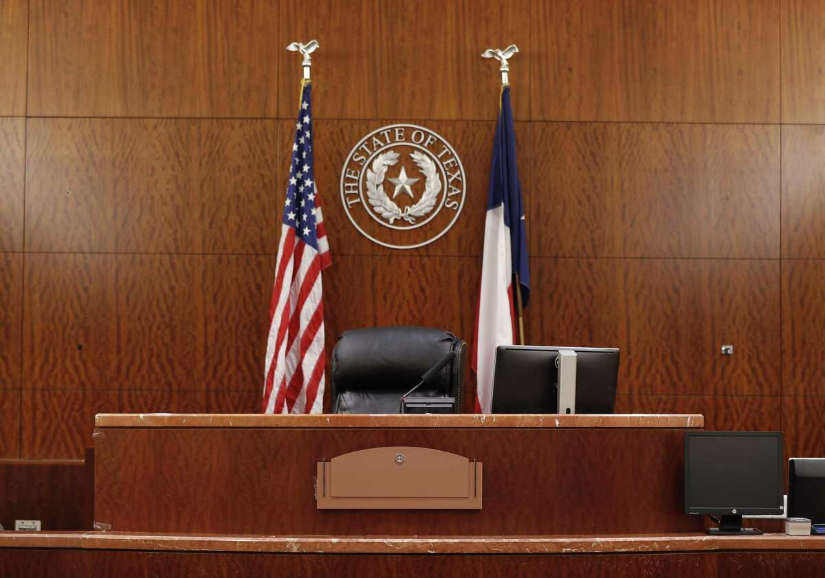 A blank judge's nameplate in a courtroom on the 17th floor of the Harris County Criminal Justice Center, 1201 Franklin, Friday, May 18, 2018, in Houston, which is to be reopened soon. The reopened courtroms will be shared among the judges, which is why the nameplate is blank. ( Karen Warren / Houston Chronicle )