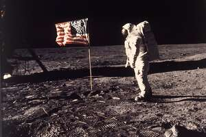 """FILE - In this July 20, 1969 file photo,  Astronaut Edwin E. """"Buzz"""" Aldrin Jr.  poses for a photograph beside the U.S. flag deployed on the moon during the Apollo 11 mission.   (AP Photo/Neil Armstrong, NASA, file)"""