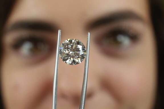 Caroline Farr holds a 5.66 E SI1 laboratory grown diamond at Wolf Diamonds 1777 Sage Rd  Friday, July 6, 2018, in Houston. ( Steve Gonzales / Houston Chronicle )