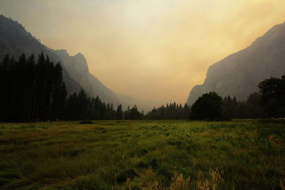 Yosemite Valley appears eerie choked in smoke from the Ferguson Fire on July 18, 2018.